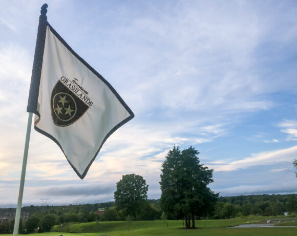 Foxland Golf and Country Club flag over golf course at sunset