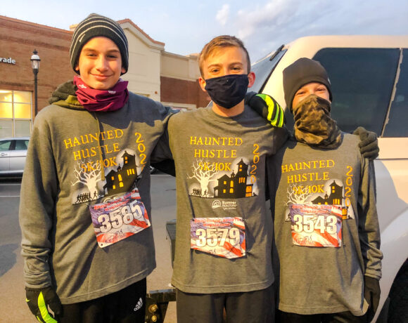 Group of runners wearing 2020 Haunted Hustle event shirts