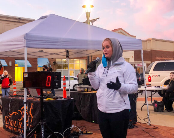 Sumner County Habitat for Humanity Executive Director Kate Ritchie speaks to group of runners